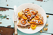 Yellow plum tart with crumbles