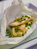 Fish fillets with peas and puree in parchment paper