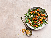 Roast squash salad with feta and toasted seeds