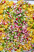 Potato salad with radishes, cucumbers and spring onions