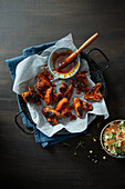 Chicken wings with homemade bbq sauce, celeriac and blue cheese slaw