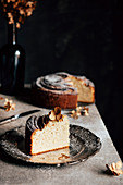 Banana bread, sliced on a table against a black background