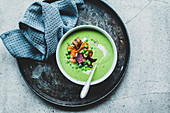 Pea and mint soup with vegetable chips and cream fraiche