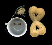 Laughing coffee cup with heart cookies