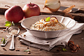 Gorgonzola risotto with apple chips and roasted hazelnuts
