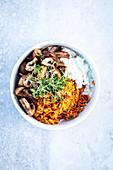 Greek rice bowl with mushrooms and tsatziki
