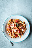 Pasta in tomato and cream sauce with prawns