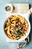Penne in cream sauce with dried tomatoes