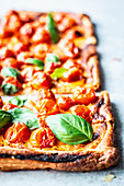 Puff pastry pizza with tomatoes