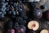 Autumn fruits: red grapes, blackberries and plums