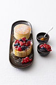 Japanese pancakes with fresh berries and acacia honey