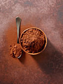 Cocoa powder in a bowl and on a teaspoon