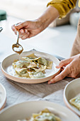 Mushroom and rapini agnolotti with warm anchovy butter