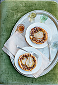 Caramelised pear and pecan nut tartlets