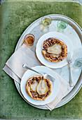 Caramelised pear and pecan nut tartlets