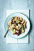 Tortellini aglio e olio with dried tomatoes