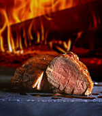 Beef fillet in front of a wood-fired oven