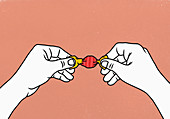 Hands opening wrapped candy (Illustration)