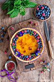 Berry brulee tart with saffron