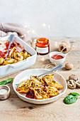 Gefüllte Muschelnudeln mit Kürbis, Spinat, Tomaten und Walnüssen