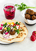 Pita bread with falafel, hummus and vegetables