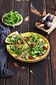 Socca pizza with figs and rocket