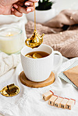 Tea with a golden tea infuser