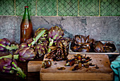 Artichokes on a kitchen work surface and a wooden board