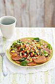 Seitan carpaccio with a vegetable salad