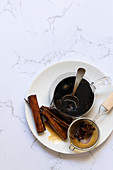 Spiced chai syrup with cinnamon sticks and star of anise.