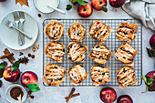 Apple and hazelnut pull-apart muffins on a cooling grid