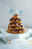 Profiteroles tower with cream, dark chocolate and praline.