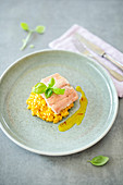 Pumpkin risotto with salmon trout and an orange and saffron sauce