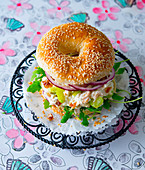 Bagel with chicken salad, red onions and rocket