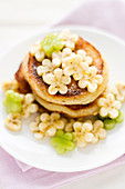 Coconut pancakes with flower shaped banana and kiwi slices