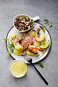 Cod saltimbocca with mango rice salad and king prawns