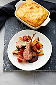 Saddle of lamb on polenta with tomatoes and king trumpet mushrooms