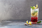 Pomegranate Spritz with tonic water, lemon and mint