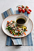 Squid and vegetable salad with sepia vinaigrette