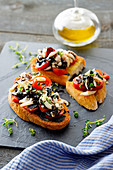 Sepia crostini with cherry tomatoes and squid