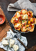 Stuffed pasta rolls with pumpkin, cheese and tomato sauce