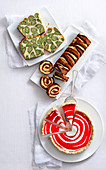 Leopard cake with matcha tea, a tiger Swiss roll with cocoa and a red-and-white zebra cheesecake