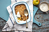 Apple crumble in an enamel tin