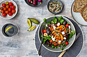 Watercress salad with beetroot, sweet potatoes, tomatoes and feta