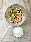 Pan fried tofu with vegetables, sprouts and rice