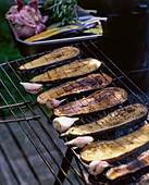 Eggplant and garlic on a grill