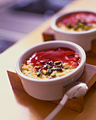 Flan with pistachios and berry coulis