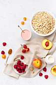 Breakfast with oats, raspberries and peaches