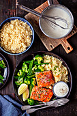 Baked salmon with cocuscous, veggies and lemon sauce
