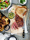 Grilled flank steak and artichokes